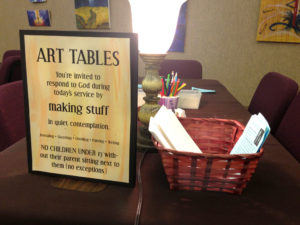 The church art table instruction sign.